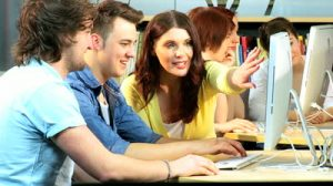 stock-footage-female-lecturer-e-learning-group-of-indian-and-caucasian-university-classmates-new-it-technology